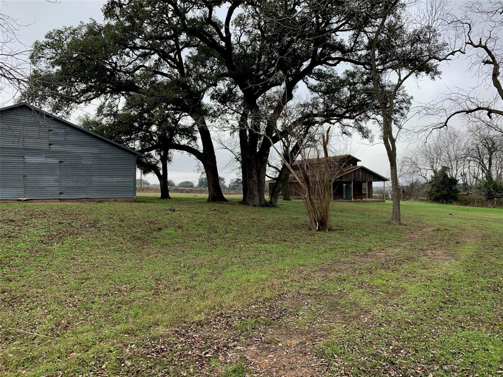 """Wonderful Country Property with 56.32 Acres in Lavaca County near Moulton, Texas. There is a house and barn on the property that are being sold in """"as is"""" condition. Many trees throughout the property."""