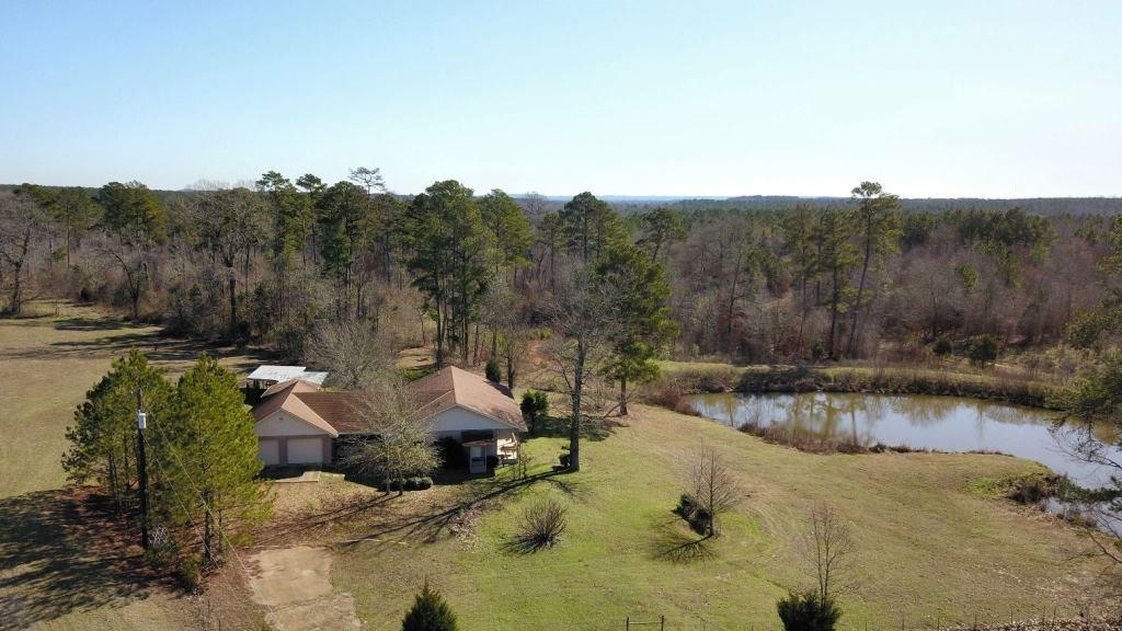 """Here's the place you've been looking for! 45.57 acres with a beautiful lake that is spring fed, 5 acres pine seedlings planted in 2016, 14 acre hay meadow, 4 bedr, 3.5 bath &  2 car garage. To Convey: propane tank, washer/drryer, refrigerator, 2009 John Deere 3032E tractor with rotary cutter, loader & grappler, 2006 Cub Cadet SLT1554 garden tractor, 2013 Honda black max 22"""" cut mowerr. Sellers built lake in 2014 & planted 5 acres of pine seedlings in 2016."""