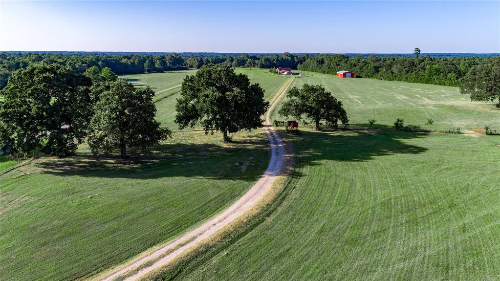 30.129 Acres in the most sought after region of Montgomery County! Secluded yet conveniently located just minutes from downtown Montgomery. A 3000 sq. ft  3 bdrm 2 bath home with add on office space or mother n laws quarters, tank less water heater, Hickory cabinets, knotty-pine doors, Granite, Large window over looking pool and back yard views. Beyond the fenced yard lies all Bermuda Jiggs improved pastures, completely fenced and cross fenced with custom cattle guards and automatic gate entrance. There is a 40x50 drive through shop with a 12x50 loft and two 16x16 roll-up doors just walking distance from home. Inside you find your own private well thats 500 foot deep and produces 80 gallons/minute. Electrical service of 440 amps. Up the hill you find a 40x100 hay barn, a 25x40 small equipment shed, and a 50 foot large equipment shed. Overhead Gas and Diesel fuel tanks are also included. This property is gorgeous and built to last a lifetime. Don't miss out on this Amazing Ranch.