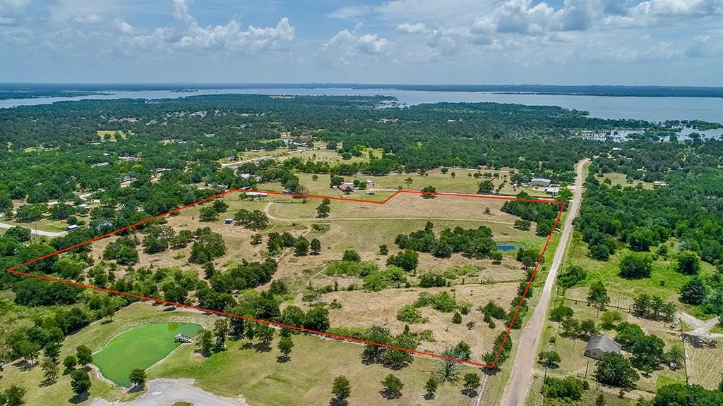 This property has POTENTIAL written ALL over it, whether you want to invest or enjoy a weekend getaway to the lake! If you're looking for an investment, the land was previously subdivided into 27 half acre lots. A recorded plat is available. Seller believes there is a water main that runs through the property. Road infrastructure for a subdivision was started in the past. This project could EASILY be picked up where it was left off with the opportunity to make a PROFIT! There's a brick home in the back corner of the property that needs quite a bit of TLC, but the potential is there. If a development isn't what you're wanting, this land is gorgeous just the way it sits. It boasts 2 ponds, gorgeous established oak trees, perimeter fencing, & portions of cross fencing. You're within minutes of Lake Somerville and close to Brenham.