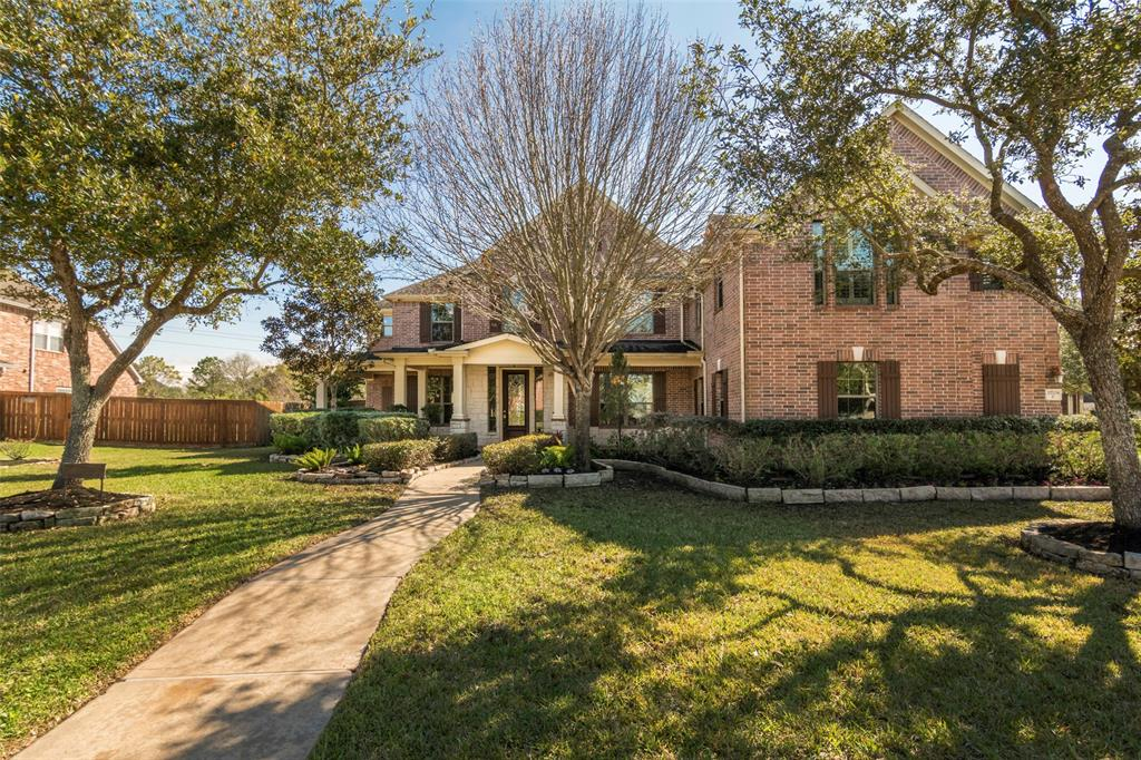 You'll absolutely fall in love with this executive-style home situated on over half an acre in a quiet gated community! Stunning, newly remodeled interior with new wood-tile flooring and all new carpet. Impressive foyer situated next to formal dining room and study. Private study with French doors. Formal dining with butler's pantry connects to the kitchen that includes granite counters, SS appliances & large walk-in pantry. The family room boasts a stone fireplace, as well as, extra-large windows that overlook the beautiful backyard. No back neighbors! Owner's retreat has sitting area w/fireplace, a walk-in closet and patio door leading to the backyard. Over-sized laundry room with built-in shelves. Upstairs features three spacious bedrooms, a huge game room, study nook and a media room. This home has it all…you won't want to leave!  No flooding!