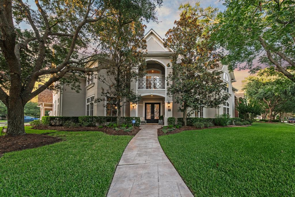 Showcasing beautiful craftmanship, this custom home rests gracefully on an oversized corner lot in the private gated community of Pecan Park Estates. Property boasts a grand foyer with sweeping iron stairway, base and double crown molding, built-ins throughout, 2-story formal living room with floor-to-ceiling windows, formal dining room, study, game room, additional upstairs study area, media room with a wet bar, and 3-car garage. The open floor plan offers a seamless transition from the family room to the incredible gourmet island kitchen with granite countertops, under cabinet lighting, butler's pantry, and stainless-steel Bosch appliances, including a double oven. Enjoy quiet evenings in the master suite featuring a sitting room and private patio access, 2 walk-in closets, separate vanities, whirlpool tub, and frameless shower. Lush landscaping compliments the impressive backyard, which features a covered patio, fully equipped outdoor kitchen, and sparkling pool.