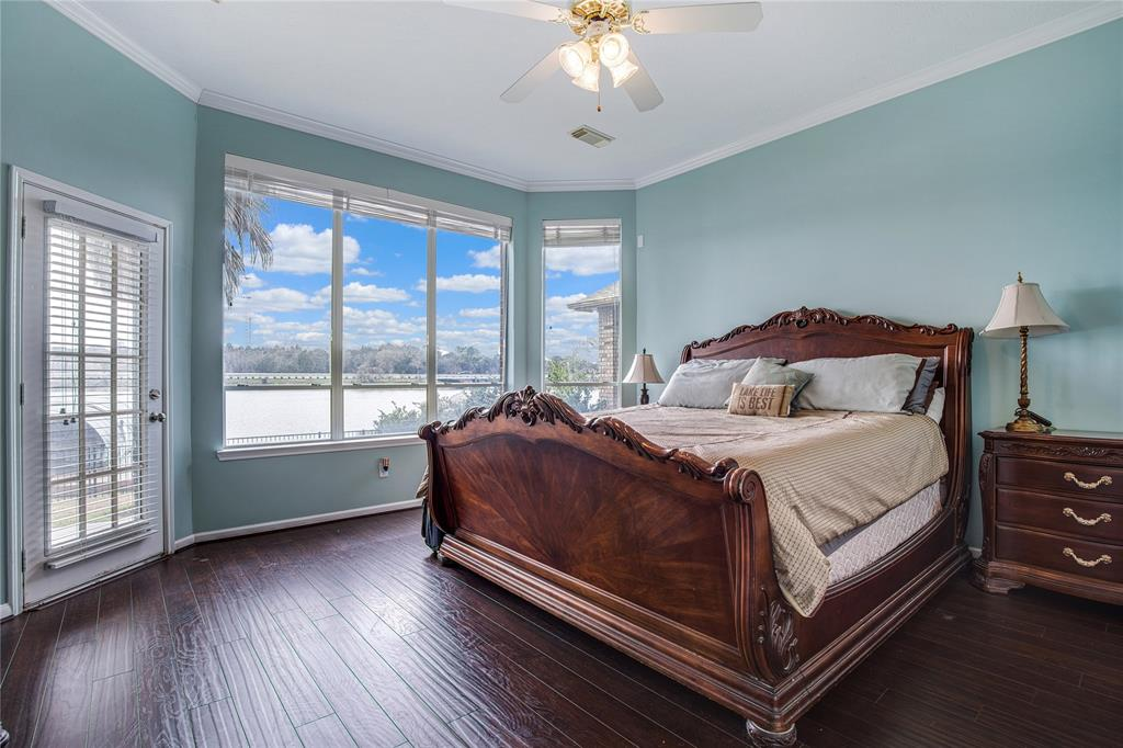 Relax in the Master Bedroom with a panoramic lakefront view