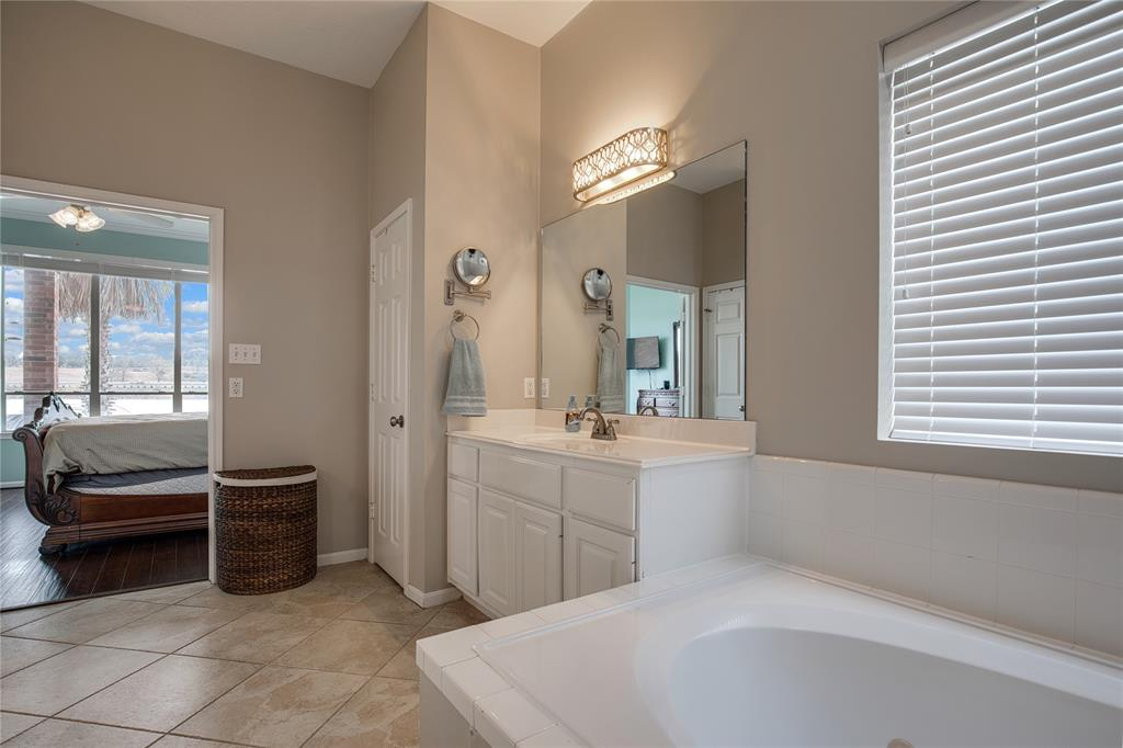 Master Bathroom features a jetted tub and separate walk-in shower