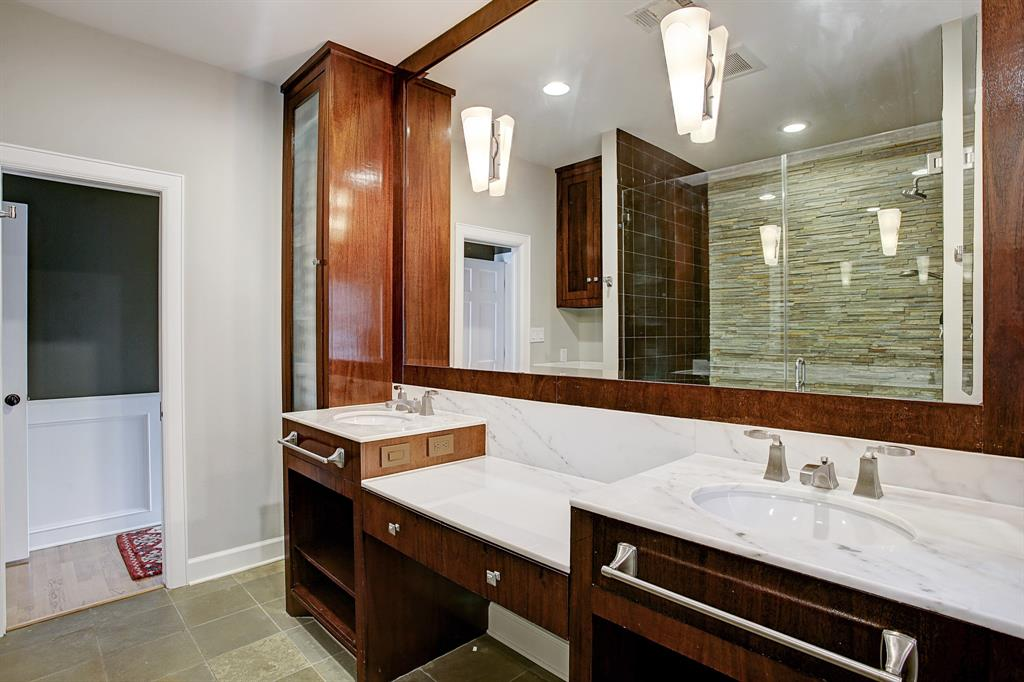 The master bath has great storage, double sinks and a vanity area.
