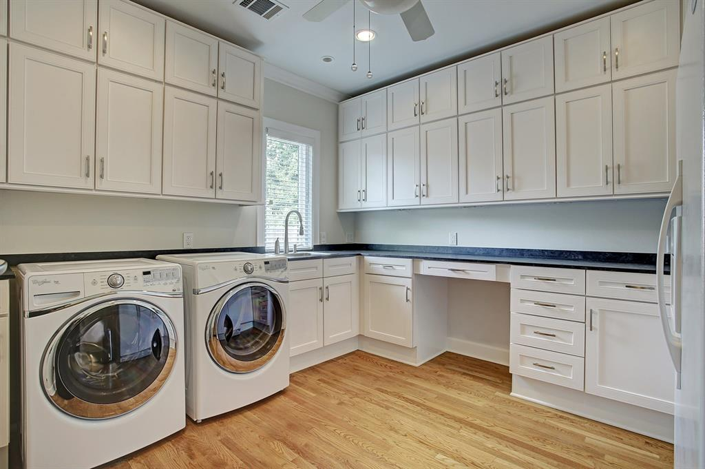 The laundry/utility room includes a second refrigerator and an insane amount of cabinet/storage space.