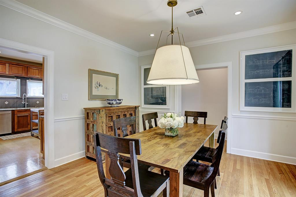 This space very comfortably accommodates a six to eight person table and sideboard, and could certainly take more/bigger furniture.  The doorway to the right leads to the second bedroom, laundry, secondary entry from the gated driveway and master suite.
