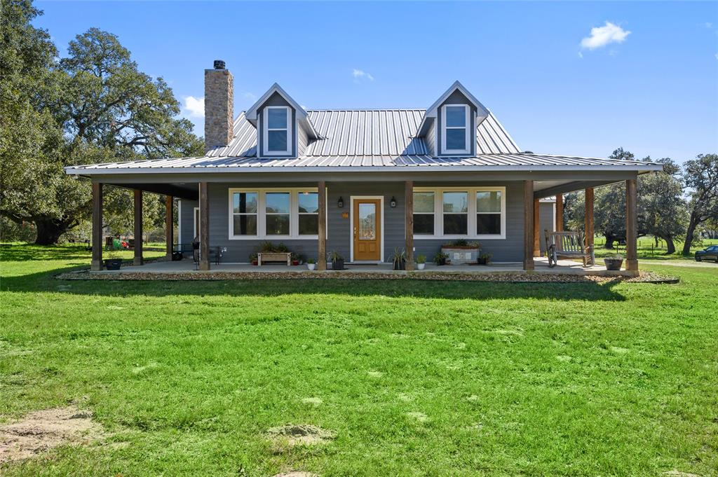 The sprawling Live Oaks and the newly constructed farmhouse is what dreams are made of! The 18.22 acres has trees scattered from front to back providing a beautiful view from the wraparound porch . The home has an open concept floor plan perfect for an active family or for the attentive host. Also on the property is 3 barns lined with stalls and storage rooms perfect for the horse enthusiast or FFA/4H projects. This property has so much to offer that it must be seen in person to truly understand! 24 hours notice is requested for all showings.