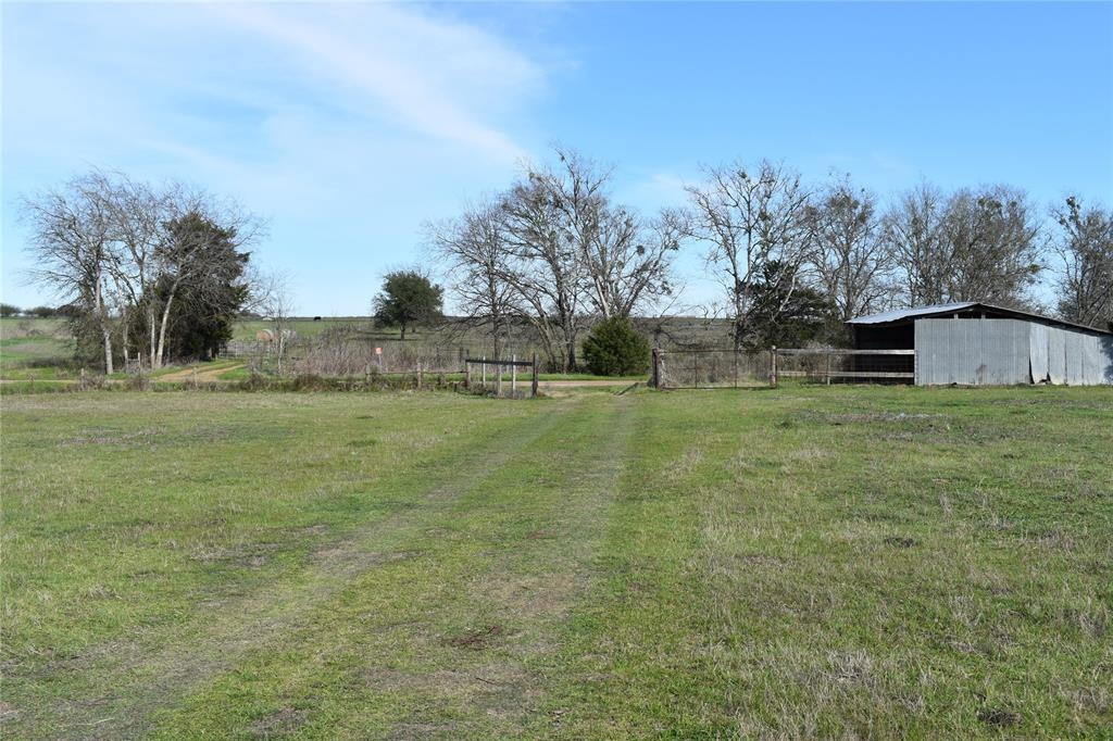 Ag-exempt acreage centrally located between College Station and Austin just north of HWY 21. Property has a few trees (mesquite and Hackberry Oak), pond, intermittent Boggy Branch, barn w/corral, all sides fenced, and food plot for wildlife. Wildlife types include deer, hogs, dove and ducks. Electricity and Lee Co. Water access on CR 404. Partial minerals negotiable. Active mineral lease. Perfect place to build your weekend getaway or to build a new home!