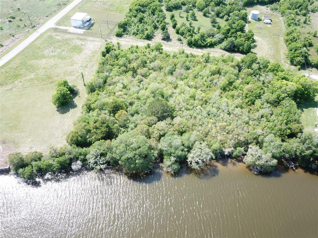 PRIME UNRESTRICTED INVESTMENT ACREAGE WITH APPROX 450' ON CANEY CREEK!  These two parcels do have a road easement from Live Oak Bend where water and sewer runs through for your tap.  Access from there or from CR 286.  This is a valuable piece as it sits in between two very nice deed restricted subdivisions on Caney Creek which is small resort fishing town just 80 miles southwest from Houston.  You are just minutes from the beach and about 15 minutes by boat to the ICW which takes you to East Matagorda Bay, or through Mitchell's cut into the gulf that can accommodate that offshore fast boat!  This property would be great to put boat barns, RV park, and develop the Creek area with a convenience store and a MUCH NEEDED gas station for those 100's of outboards on the creek!  This parcel would be a great mixed use business venture!