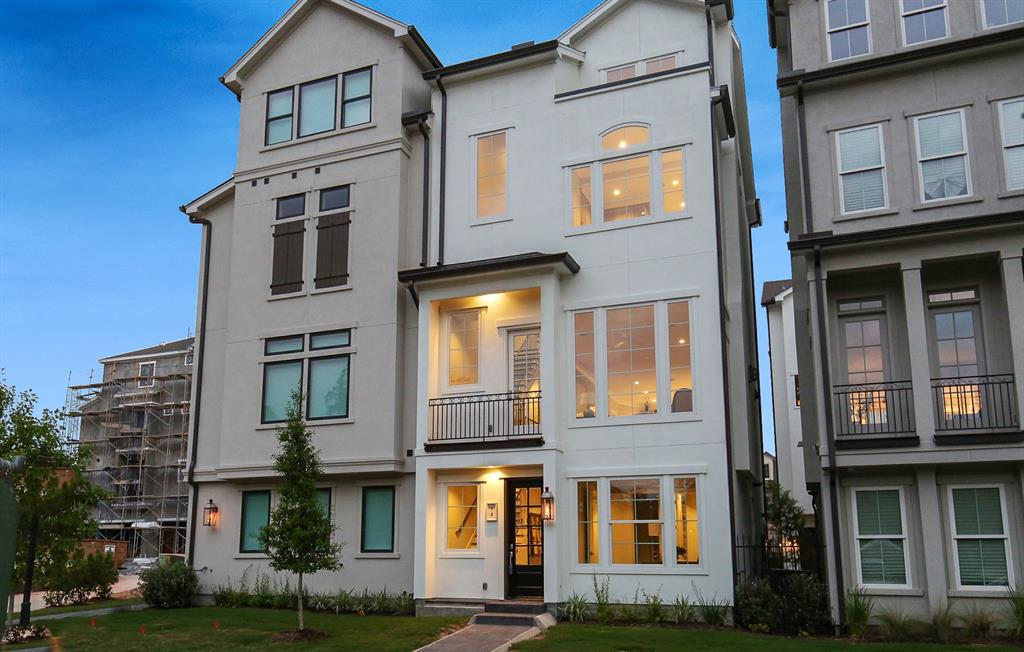 "Completed by Waterway Builders and never lived in, this popular Afton Model is the last one left and was chosen as the model plan for the complex.  The owner has loaded the home with upgrades included a tower wine frig, elevator, wood floors throughout along with tile and fixture upgrades.  Situated behind the gates of this private enclave in East Shore, residents have a private access to walk along the Waterway to Hughes Landing, Market Street, and the Town Center and Mall.  This elegant unit has four stories of bright, charming, living with easy, carefree living.  A bedroom on the first floor can be a study, second floor living areas, third floor private master suite with lush bathroom with free standing tub and adjoining Coffee bar.  Fourth floor contains a bedroom/bath and game room with elevator to all four floors.  Balcony's overlook a lovely central park ""island"".  Amenities include East Shore parks, private clubhouse and pool, and 24 hour security patrols."