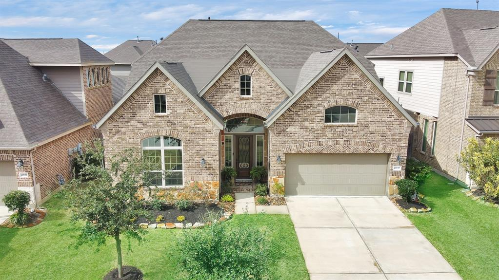 Stunning 3 bed, 3 full bath, 1.5 story home in the Lakes at Avalon Village! Zoned to Klein ISD, this open floor plan is great for both living and entertaining; featuring soaring ceilings, modern finishes, and an amazing outdoor patio that has to be seen to be believed! The Kitchen boasts SS appliances, ample storage, walk-in pantry & Oversize Island/Breakfast Bar, which opens to the Breakfast room and spacious Family room. Sizable Dining Room with both a Media Room and separate Game Room. Huge Master Retreat, complete with en suite bath & large Walk-in Closet, ensures privacy in this Split Plan. Schedule your showing today!