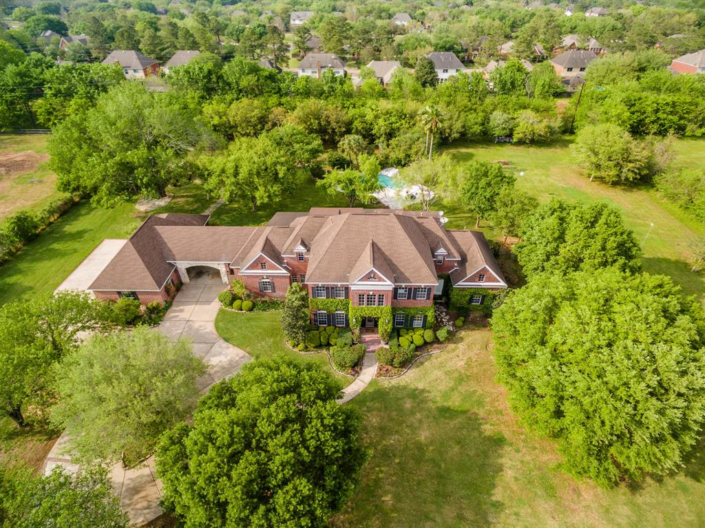 INCREDIBLE OPPORTUNITY TO OWN THIS GORGEOUS COUNTRY ESTATE SITUATED ON OVER 3 ACRES IN THE HEART OF SUGAR LAND! ENJOY THE LUXURY ACREAGE LIFESTYLE WITH ALL THE CONVENIENCES OF CITY LIVING. TERRIFIC FLOOR PLAN WITH BOTH FORMALS, LARGE FAMILY ROOM HAS A WET BAR & OVERLOOKS THE GROUNDS. BEAUTIFULLY UPDATED ISLAND KITCHEN FEATURES TONS OF COUNTER SPACE, STAINLESS APPLIANCES, AND TRAVERTINE FLOORS. ROMANTIC MASTER SUITE WITH SITTING AREA HAS VIEWS TO THE FRONT AND BACK OF THE PROPERTY, SPA-LIKE MASTER BATH HAS BEEN UPDATED WITH MARBLE COUNTERTOPS, NEW SHOWER TILE & GLASS. LARGE HIS/HERS CLOSETS. GAMEROOM DOWNSTAIRS HAS A FULL BATH AND CAN ALSO BE USED AS A SECOND BEDROOM DOWN. UPSTAIRS 4 BEDROOMS WITH UPDATED BATHROOMS. ONE OF THE BEDROOMS IS BEING USED AS A STUDY. INCREDIBLE POOL WITH HOT TUB, GARDEN AREA, 4 CAR GARAGE, SO MUCH LAND, LOW TAX RATE & SO MUCH MORE! ZONED TO EXEMPLARY FORT BEND SCHOOLS INCLUDING CLEMENTS HS. MINUTES TO EVERYTHING INCL HWYS 6, 59 & FORT BEND TOLL ROAD.