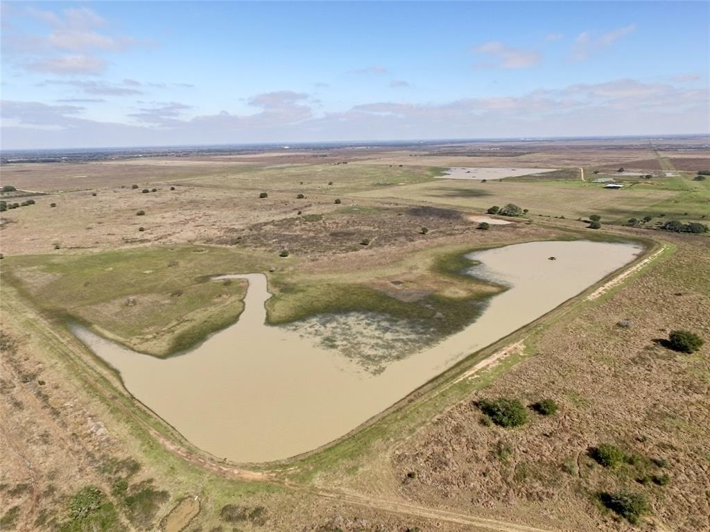 "Located just 20 minutes west of Eagle Lake, the ""goose hunting capital of the world"", this 181.88 acre tract is highlighted by a 55+/- acre Ducks Unlimited pond installed in 2003. Situated 20 miles south of Columbus I-10 Exit 696, this property offers a mix of hunting & ranching opportunities featuring sandy loam soil, 220' elevation, 100' paved CR 106 frontage, 896.75' gravel CR 141 frontage, electricity with RV hook-up, water well casing approx. 80-100' deep, scattered Live Oaks, native pastureland & 2 stock ponds. Wildlife includes deer, hogs, dove, a variety of ducks & sandhill crane, better known as the ""rib eye of the sky."" The property is located within 1 hour of Buc-ee's in Katy, less than 30 minutes from Splashway Water Park in Sheridan & within 2 hours of Houston, San Antonio & Austin. The property is ag-exempt through cattle grazing keeping taxes to a minimum ($332.75 in 2019)."