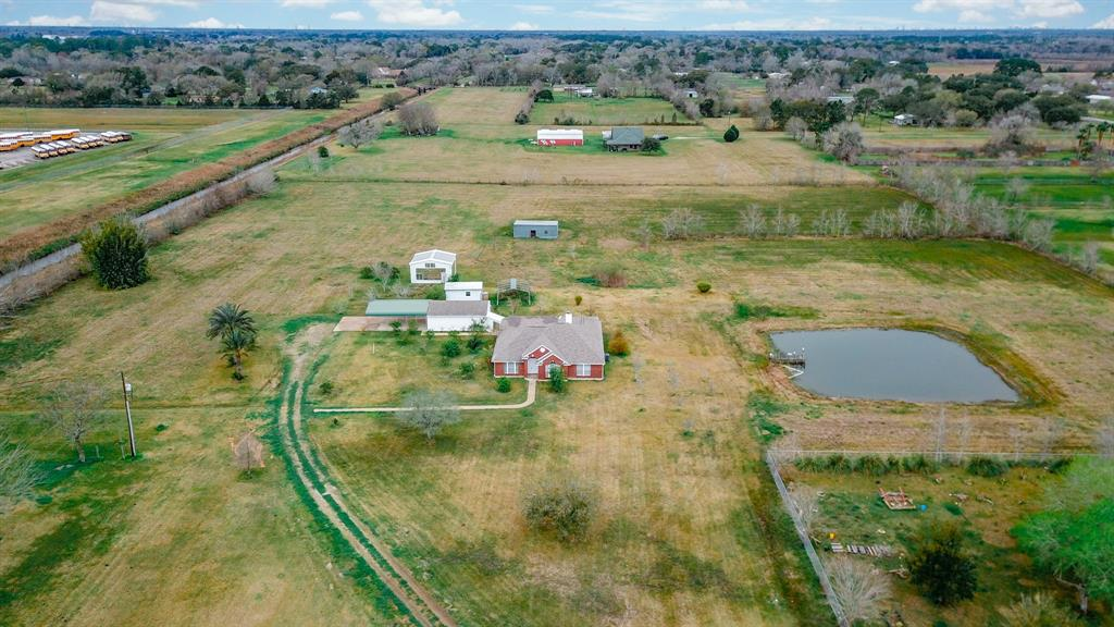 Welcome to 2241 Cardinal Drive located on County Road 149 and home to 11 ACRES of Land with a Single Story 3 Bedrooms 2 Full Baths Home situated less then a minute away from Hwy 6 & few mins from Hwy 288. The Beautiful Country Home Features Formal Dining with a Charming Chandelier and a Spacious Family Room w/ High Ceilings along with a Wood Burning Fireplace. Kitchen w/ Island and lots of Cabinetry. Master with en-suite Bathroom and is equipped with a Jacuzzi Tub, Stand-in Shower, Dual Vanities and a Huge Walk-in Closet.  Acreage featuring private pasture with imported Fruit Trees from all over the world along with a Private Pond, Greenhouse, dedicated vegetable garden, animal shelter perfect for your livestock, an over-sized detached framed Garage and several storage sheds to name the few.  The back porch was framed in with two additional bonus flex rooms that can be used for entertaining, game room or countless other possibilities. Enjoy Country Living at its finest! WILL NOT LAST!!