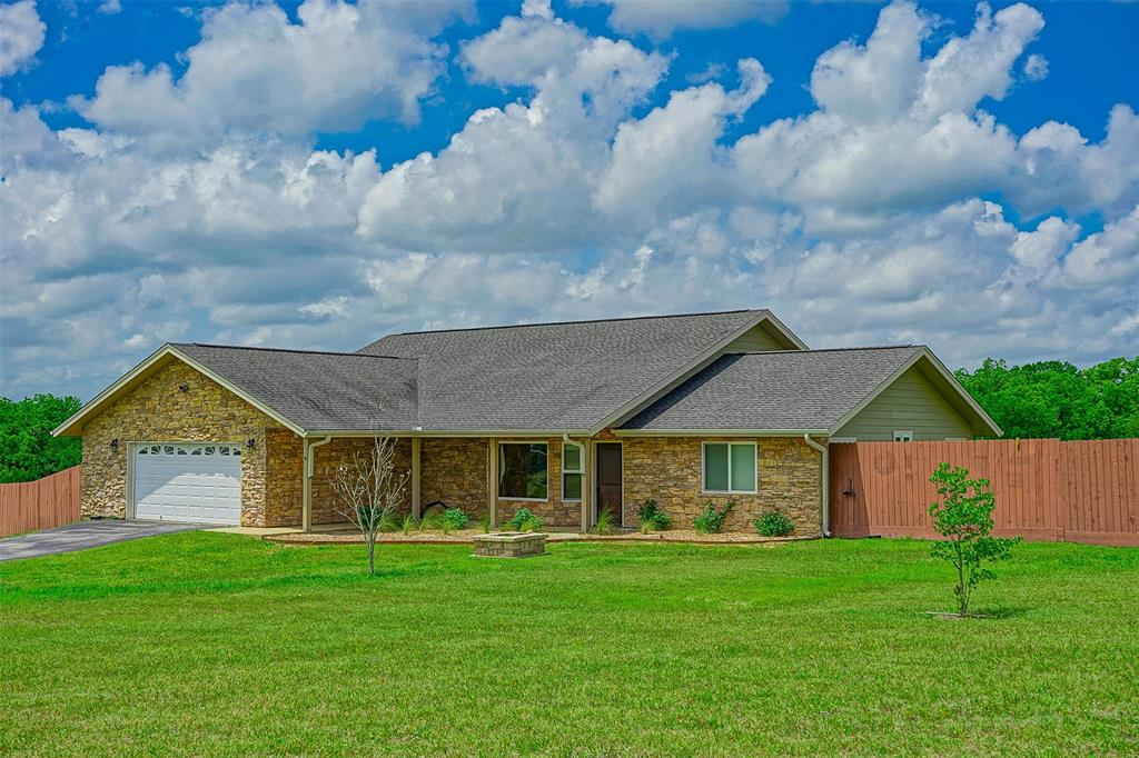 Just outside of Navasota and within easy commuting distance of College Station is this beautiful 1813 Sqft 3 Bed/2 Bath home on 11.7 acres. The 2010 built home features a split, open floor plan with stainless steel appliances, island with bar seating, granite counter tops and large windows to enjoy the long distance hilltop views. Outside both front and back porches are stamped concrete and there is a huge fenced back yard for the kids and dogs to play. The 11.7 Ag exempt acres are ideal for livestock and/or 4-H and FFA projects. Plus there is a 4 car carport, additional septic, storage building, and underground electric. Don't miss your chance to see this move-in ready home today.