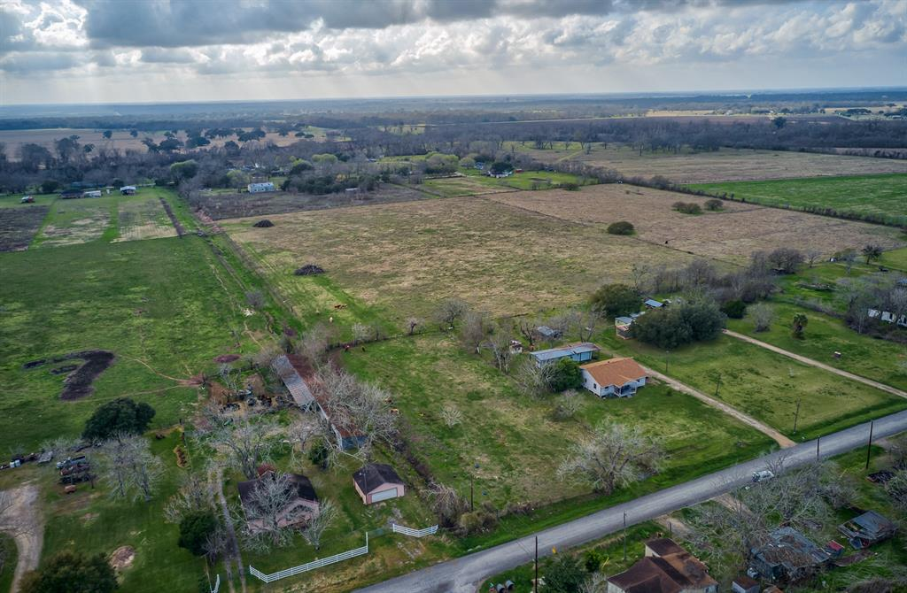 Over 12.26 +/- Unrestricted - Sprawling Acres in Wharton! Just minutes to HWY 59 or Downtown Wharton. Build your Dream Home or Make this Your Country Getaway!