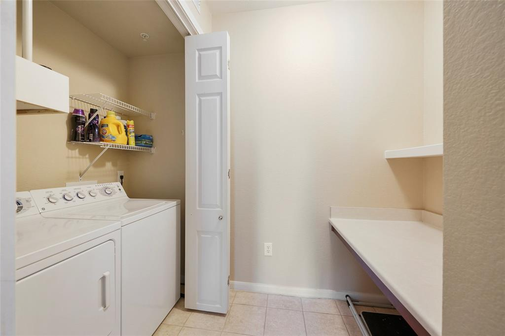 Convenient private laundry room.