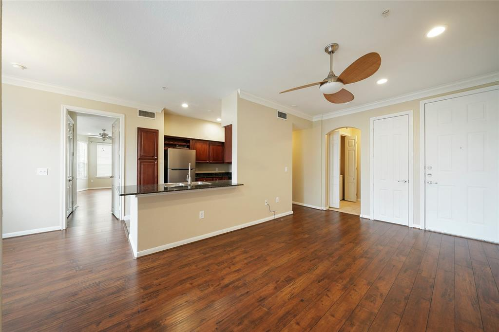 Spacious living and kitchen areas with beautiful new floors.