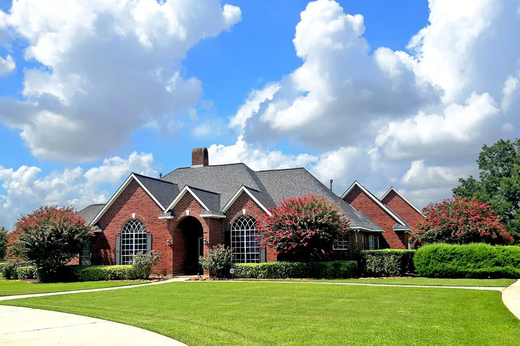 This incredible home is on 2+acres in the beautiful equestrian community of Grand River. The main home has 3 bedrooms, 2 full and 2 half baths, formal dining room open to the living room, high ceilings, porcelain tile floors (2018), new air conditioners (2019 & 2020), 2-sided fireplace, and cathedral windows. The spacious kitchen has custom cabinets, granite countertops (2020), stainless appliances, and sunny breakfast area. The owner's suite has a sitting area with a wall of windows overlooking the back lawn, an elegant bath with jetted tub, 2 walk-in closets, and dual vanities. The phenomenal second floor features a craft room, gym, media/game room, and a screened in balcony. The attached guest/multi-generational suite (built in 2007) has a private entrance, 2 ensuite bedrooms, living room, kitchen, laundry room, half bath, engineered hardwood flooring (2019), and screened-in porch. Also, there is a 4-car attached garage, stand-by generator, new roof (2018), and has NEVER FLOODED.