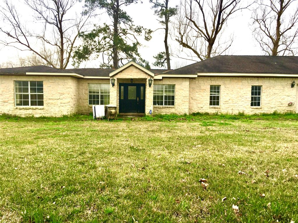 Investor flip opportunity.  This 3 bedroom, 2 bath home sits on 3.59 unrestricted acres.  The home is made of Austin Limestone and it features a 3 car garage, a sunroom, granite countertops.   Iron gates out front.   This home has flooded and is gutted and ready for renovation