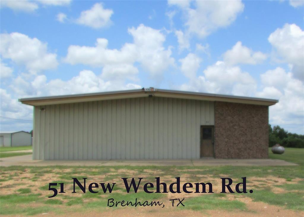 Build your dream home with shop in already place - 5000 sqft of interior space - solid metal structure -- fully insulated. Nearly 3000 sqft of exterior slab area on 1.83 acre tract. 3 10ft roll-up doors. 3 walk through doors. est 11ft clearance to the beams. est 12-13ft clearance between beams. 1 private office area. 2 recently updated 1/2 baths.