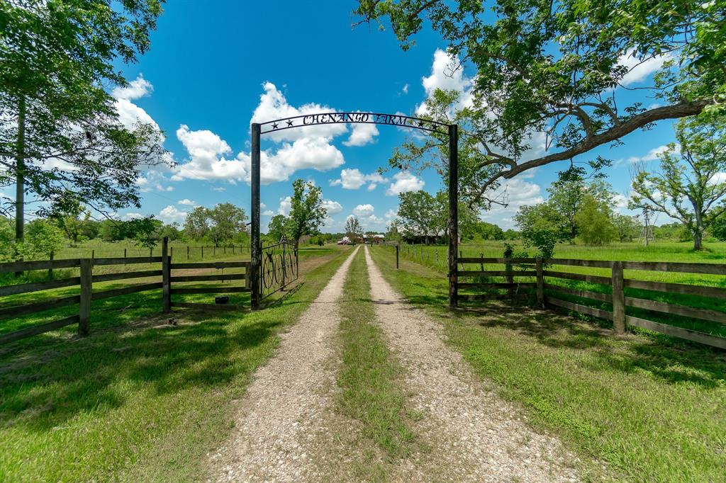 Beautifully updated home on 30.5 acres of cross-fenced land. Perfect for Buyer with cattle, horses, goats, etc. Cross fenced with 6 pastures, special grass planted, storage building with concrete floor (1600SF) has A/C, Full Bath & tack room, lean to for equipment, 2 pole barns, 1 w/ tack room, 3 ponds, 3 water wells so all have fresh water. 2 deer blinds stay w/ property. 25 acres are AG exempt so taxes are more reasonable. Great pool to enjoy on the hot summer days with a 432' cabana canopy to relax under! Close drive to City of Angleton for shopping and restaurants. Like to hunt, no neighbors on two sides. Two deer blinds stay with property. You will fall in love with this property: the screened porches, the peacefulness, and the fresh air & nature sounds. Come take a peek at your new country home! Working in Houston? Short 45 min drive. Working in Freeport? Short 30 min drive.