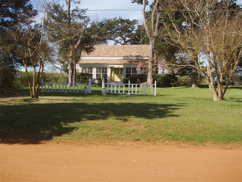Well-maintained 1895 farmhouse on 52.75 acres. Pasture has been well kept by neighbors. High ceilings, large formal living and dining, cozy den, good size kitchen, large master bedroom, enclosed sun porch across the width of front. Large cedar trees shade the yard. enclosed pens for pets, storage shed, small carport. Dimensions approximate. Storm damage in process of repair; two large trees were destroyed - see pictures