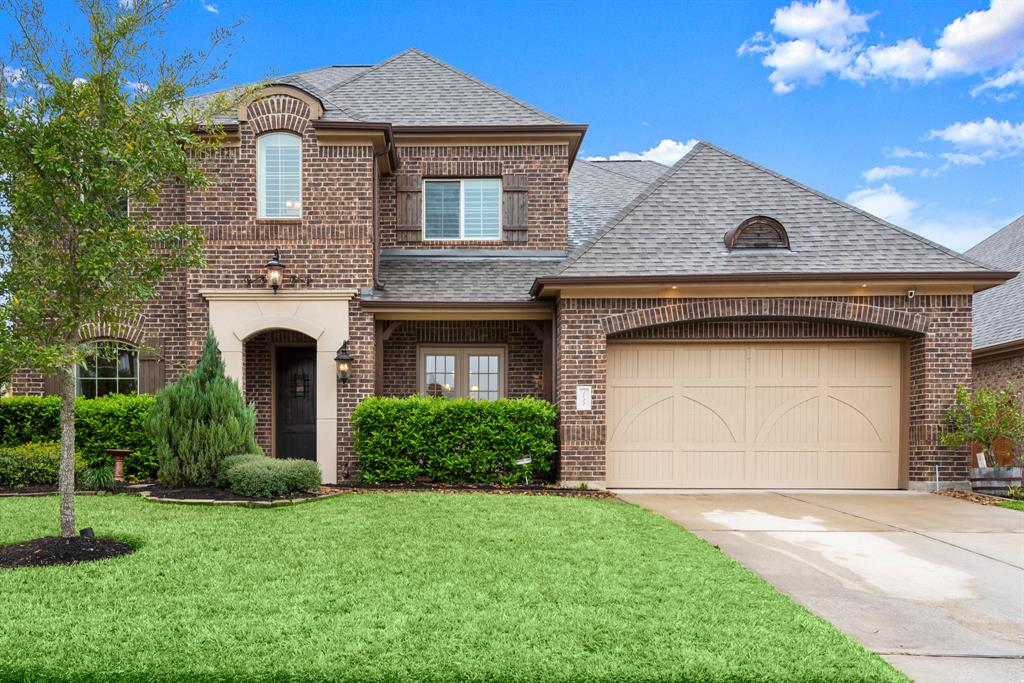 Immaculate Brick Emerald home in Holly Chapple of Jacobs Reserve.  This home shines with the pride of original homeowners.  Features include handscraped against the grain hardwood floors throughout the first floor plus the staircase to 2nd floor, high ceilings & tall windows enhanced with plantation shutters, custom paint, exquisite light fixtures, upgraded Benedettini cabinetry throughout, whole house water softener w reverse osmosis, fully equipped media room, built-in spice racks banking the cooktop vent hood, Monogram appliances inc a built-in fridge plus 6 burner cooktop, surround sound, Pool & Spa by Northside Pools with a Katch-a-Kid net, sound panels in media room, 2 walk in attic rooms with custom storage shelving added, 3 car tandem garage,  beautiful outdoor fireplace, French doors off dining room & so much more.  All this plus zoned to The Woodlands Schools, close to all The Woodlands amenities & community banked by WG Jones State Forest.