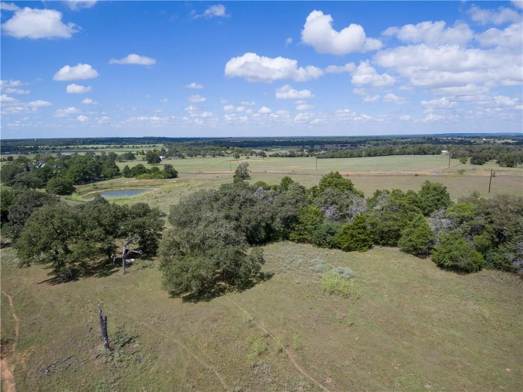60+/- Ac. for you to make your country living dreams, a reality! This 60+/- acre piece of property is AG Exempt and is to Surveyed out of a larger piece of land, providing peace and privacy. The property does include a shop with electricity! Located 13 miles from Bastrop, 35 miles from Austin Bergstrom Int. Airport and 11 miles from Smithville, puts this property in a central location for local attractions and necessary amenities while still offering true country living.