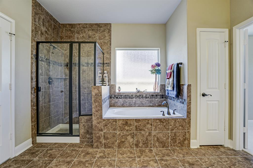 Walk-in shower and soaking tub.