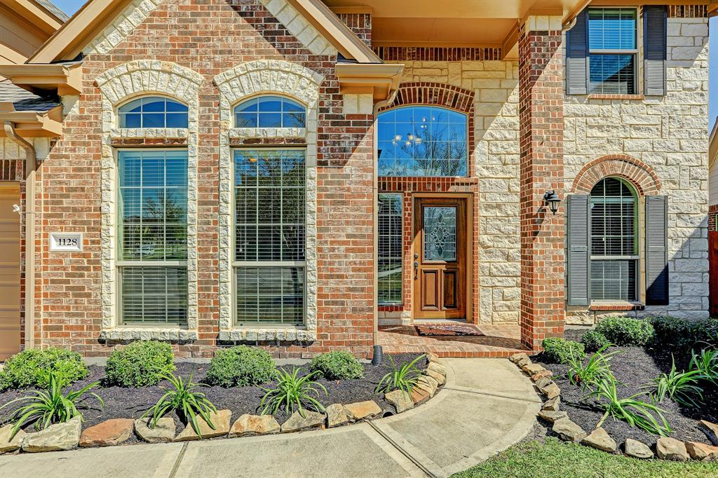 Beautiful brick and stonework showcase this homes beautiful and welcoming entry.