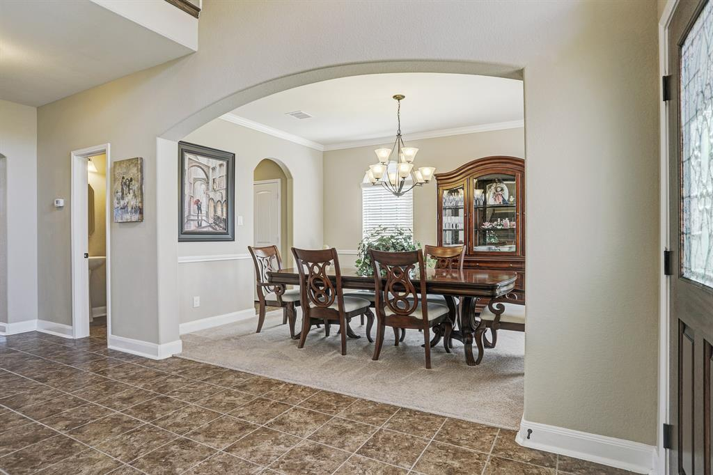 Formal dining room with ample space for your large dining table.