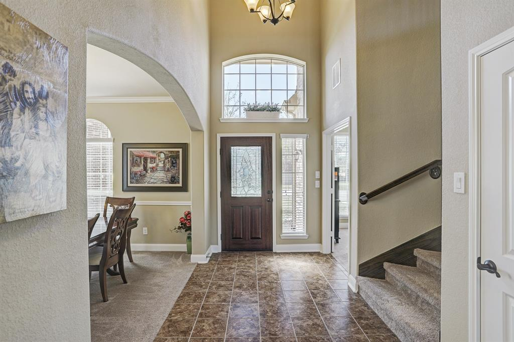 Foyer with towering ceilings and great natural light.