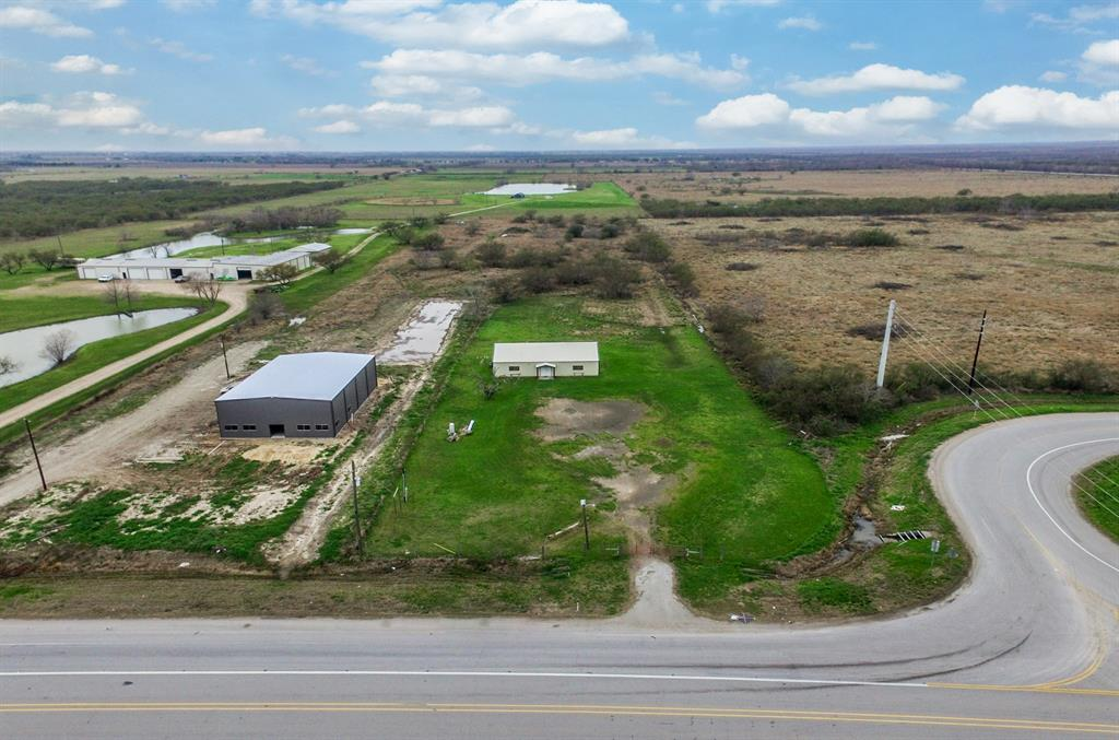 Frontage property off Spur 10!! Major traffic area right by Hwy 90 and minutes between Hwy 59 and Hwy 36. Over 5 Acres with a 2400 sqft building with an aerobic system, well, and electricity. Endless commercial / investor opportunities in a prime, highway location with very high traffic flow.