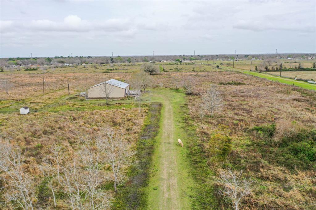 Gorgeous property on 20 acres with a 3600 square foot (60x60) steel building that is plumbed for a bathroom and can be converted to a barndominium. Has 3 12x12 roll up doors. There is a 170 gallon water well in a pump house and septic system. Property is high and dry. Bring your animals, build your dream home or whatever your heart desires.