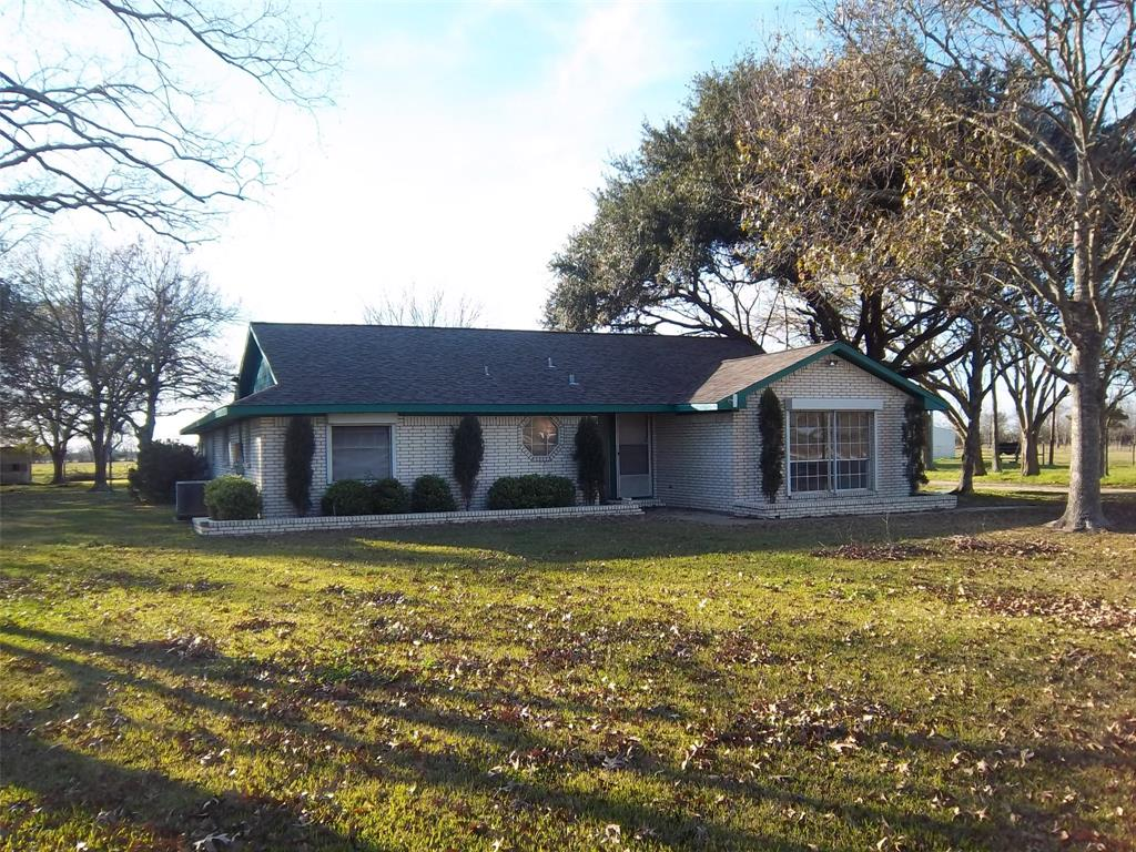 Here's your chance to buy a small ranch with large shop building.  This is a 3 bedroom 2 bath home located on 40.481 +/- acres of land. The garage has been setup as an Man cave with a potbelly wood heater.  The building is  40x120 plus a 40x40 open sided canopy.  Automatic driveway gate. The land also has unimproved access to CR 613 as well through the back pasture.