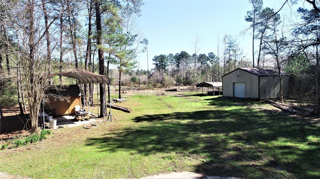 Come out to the country in growing area 24 acres that is partially cleared already has an old slab where a home you used to sit, also has a water well and septic that needs to be inspected for working conditions. 30x30 metal shop also on property property is ag exempt.