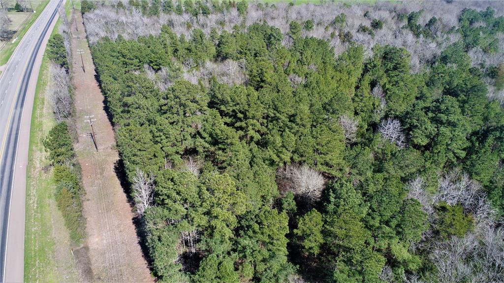 GREAT LOCATION ON HIGHWAY 21 WEST!   This 60.10-acre property is wooded and has several home-sites. This property has excellent highway frontage, and lots of deer and wildlife! Big Creek runs through the back of the property. All utilities are available at the road. This property won't last long! Call us today for more details!