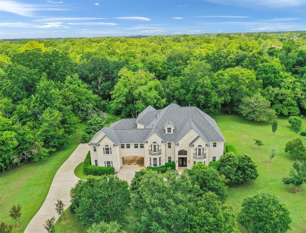 Exquisite living begins here in this massive 6,752 sq. ft home on a 4-acre lot with waterfront access. A private, custom-built, one-of-a-kind mansion set in the perfect backdrop in Sienna Point, surrounded by miles of trees, and acres of green space. This beauty boasts three kitchens, a study, game room, movie room, sun room, five bedrooms and a guest quarter on the second floor complete with a private staircase, living room, bedroom, and kitchenette. The game room features a wet bar and opens up to the balcony. This home also comes with a stunning spiral staircase, a custom elevator and two additional staircases throughout the house to allow easy & seamless access to every corner. What's more? Brand New Roof, 2016 HVAC system with 4 new units and ductwork (over $50,000 value), and existing pool connections for you to build your dream outdoor oasis. Schedule a tour today to explore this beauty in person! ASK US ABOUT THE AVAILABLE VIRTUAL TOUR LINK.
