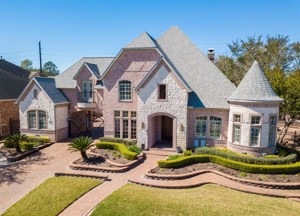 BE SURE TO WATCH THE VIRTUAL TOUR!  Stunning Custom built (Dominion Homes)in gated community with easy access to I-10 and Houston's Energy Corridor. Home has NEVER FLOODED. Just a few of the many upgrades include a turret library with hard wood floors,which make it feel like your own private castle, 20 foot ceiling in Family Room with floor to ceiling stone fireplace, heated pool with waterfall,2 covered patios, fire pit, walkway lighting, mosquito misting system and so much more for a beautiful backyard resort.  Roof and pool heater replaced in 2019 and recent carpet and cabinets.  LOW TAX area, attends award winning Katy schools. This home has so many amazing features that todays buyers want which include 2 bedrooms down both Game and Media rooms, 3 oversized garage spaces and Gourmet kitchen Master suite with custom built in closet. Your pickiest buyers will love the WOW factor this home offers!