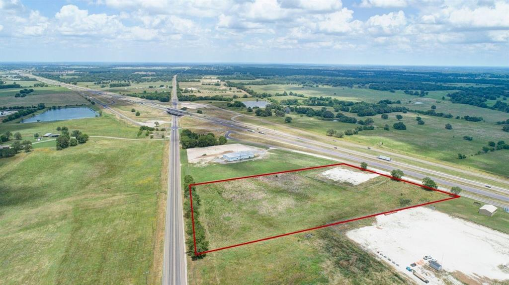 7+/- Commercial Acres centrally located in the Texas I-45 Freight Corridor.  Your business is your treasure, and a perfect business design includes a map to get you to your destination.  TxDOT declares I-45 linking Galveston, Houston, and Dallas the MOST HEAVILY traversed freight corridor in Texas and projects the highway travelers with cargo to more than double by 2040.  What does that mean for you? A wise man would build his dream in a  location that ensures success. Property fronts I-45 with 450 feet of access road for easy traffic movement, & borders 430 ft of TX-75 so traffic to you will come from TWO heavily traveled thoroughfares.  There is an entry drive from I-45 Southbound Access Road that leads to a 1 acre rock pad.  This property couldn't be placed any more perfectly at 140 miles from Dallas, 100 miles to Houston and 150 miles to Galveston in Madison County.  Successful businesses abound in the area as a result of this location. Come build with us, X marks your spot!