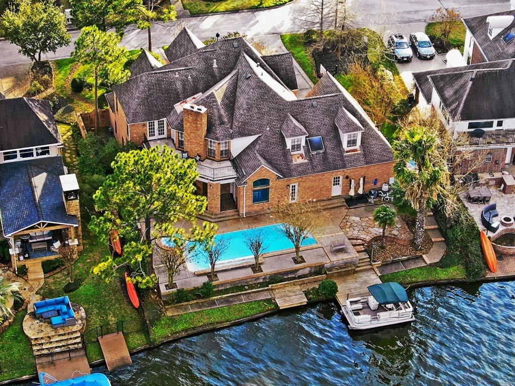 (HOME SANITIZED BETWEEN SHOWINGS (ALL DOOR KNOBS, COUNTERS) SANITIZER AT FRONT DOOR - Per Seller) Home on Lake Woodlands with boat & dock. Multiple boat docks on the Lake including Hughes Landing (with Whole Foods & restaurants), Riva Row (Cynthia Woods Pavilion / HEB / Library) and three parks (The Cove, Southshore, & Northshore).Heated pool & spa (new plaster/tile June 2019) overlook the lake with views. Half bath and laundry directly accessible from pool area. Take your own kayak or paddle board out on the lake! Home has been updated, granite throughout. Two masters, both with doors that open out to the Lake. Open plan kitchen, dining, living all looks out at the Lake. Additional living area upstairs with second fireplace and views across to the old Anadarko building. Two additional bedrooms share a jack and jill bath. Finished Texas Basement. Private side yard. Cove Park with playground & access to Woodlands bike trail network a 5 minute walk away.