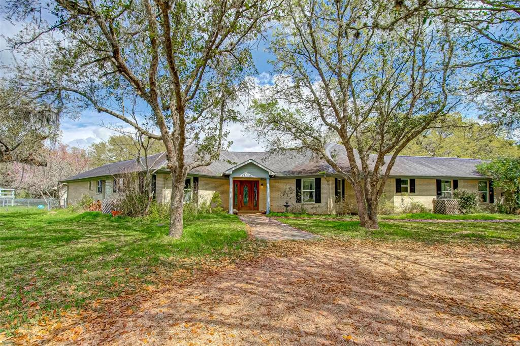 """Looking for a home with Lakefront property to settle down or a nice countryside weekend retreat? This property is ideal for nature lovers and located off FM 762 just minutes from Highway 59.  A bonus to this property is it is near the Brazos Bend State Park where you can marvel at nature, you can also hike and bike, fish, picnic, geocache, ride your horse, and stay overnight. The """"Three Sisters Farm"""" is located within Oak Lake Village where you can conveniently purchase organic fresh seasonal vegetables, local honey, and other delicious items.  This generous size 3 bed/2 bath home is equipped with a great open kitchen with island lots of cabinets for storage and so much more (interior photos coming soon).  The exterior features include:  Aerobic septic system, 2 car attached garage, covered back porch, lots of mature TREES, 2.68+/- acres, Community Lake, and LOCATION LOCATION LOCATION!"""
