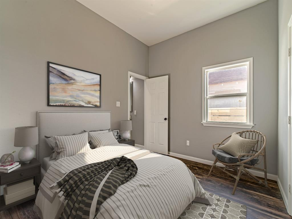 Additional bedroom with roomy closet and bathroom. (Virtually Staged)