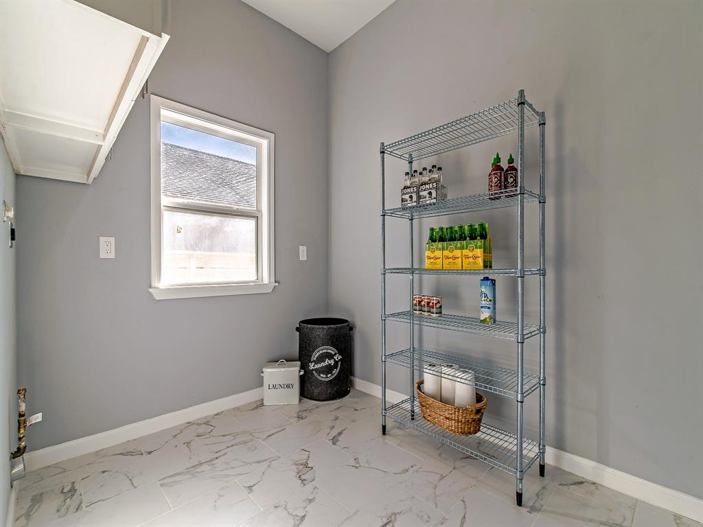 Dreamy spacious laundry room that also allows for pantry and storage use!