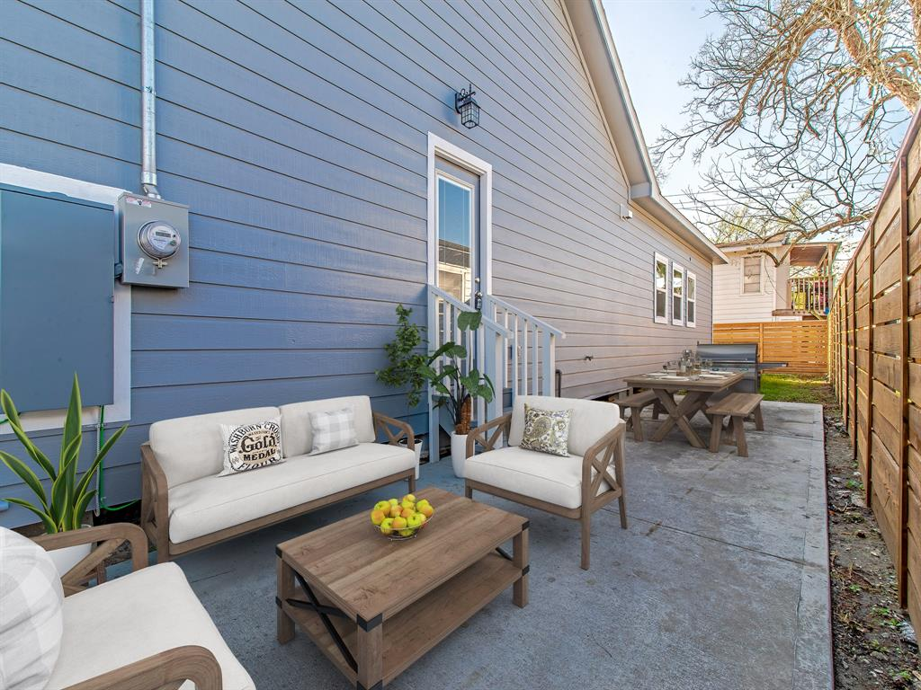Side patio area with new wood fence for privacy, plenty of space to entertain and get your grill on! (Virtually Staged)