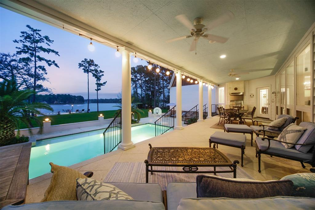 Beautiful Indigo Lake custom estate home situated on 2 wooded acres. 2 homes on property. Main house has 5789 sf, 2 elegant masters w/well appointed en suites & custom closets. Lovely den w/floor to ceiling rock gas log fireplace overlooks the beautiful patio/pool & lake. Chef's kitchen has Carrera marble farmhouse sink*Viking cook top*double ovens*lots of cabinet & counter space. Beautiful marble & wood floors on both levels. Upstairs are 2 bedrooms, full bath, flex space for sitting area*office*tv room, etc. Upstairs also includes perfect space for a game room, media or exercise room plus another HUGE space w/potential for a 5th bedroom. Much multi-functional space. Guest home has 2354 sf, 3 bedrooms, 2.5 baths. Spacious master also includes custom closet and great en suite bathroom. Great setup for parents, overflow guests. Main home has inviting pool*large covered patio*outdoor gas grill. Perfect space to entertain. 150' waterfront view*beachy area*boat launch*pier*decked area.