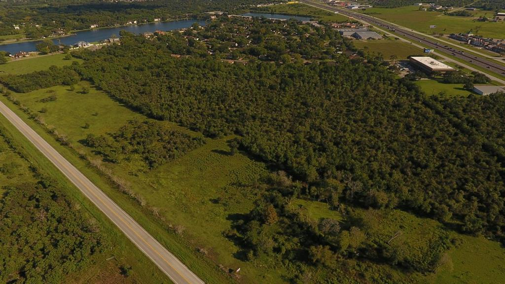 THERE ARE FOUR CONTIGUOUS TRACTS down Monticello, abutting the park and ride and fronting NB Gulf Freeway frontage road.  Call listing broker for details.  EXTREMELY good retail location with frontage and access off I-45 NB feeder, as well as access off Monticello at Century Blvd. Incredible visibility from I-45 north and south.  Property is NOT in a 100 year flood zone per the new FEMA maps found.  Please verify.  This Texas City location is a retail DREAMSPOT.  (Coming soon: hard corner at Delany/Century/Monticello per TXDOT). 