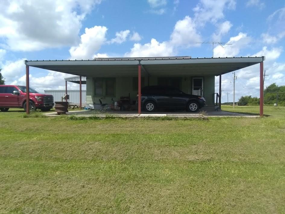 Want some quite country living?  Check out this 12 +/- acres located just outside of El Campo. Cozy 2 bedroom 1 bath wood frame farm house with a attached 2 car carport and a shop. No minerals being conveyed.  Peaceful setting on Tres Palacios creek.
